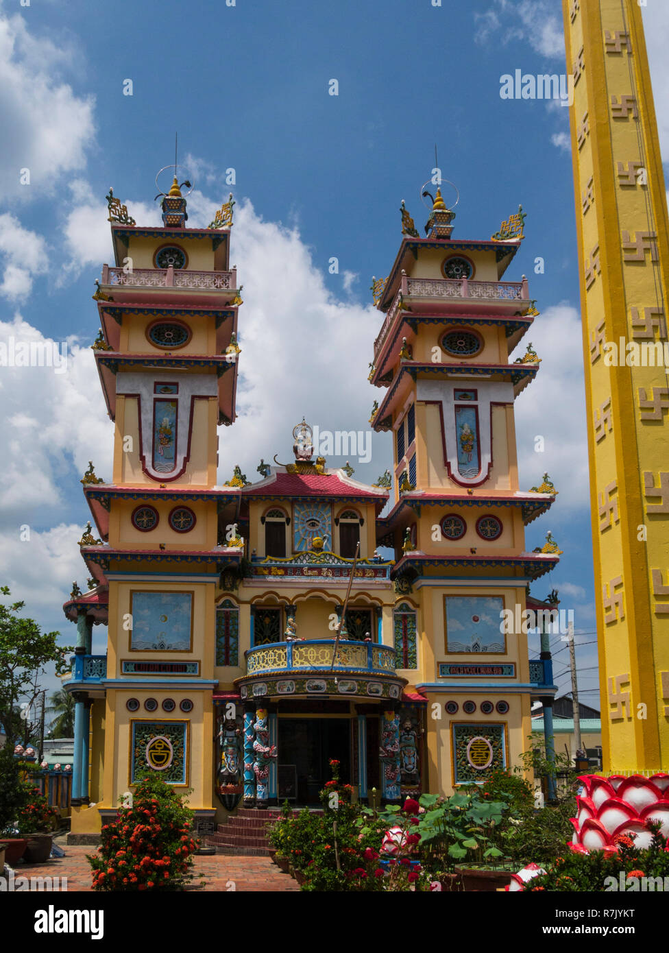 Cao Dai Temple in Cai Be symbolise local unique religion indigenous to Vietnam very ornate Vietnam Asia - Stock Image