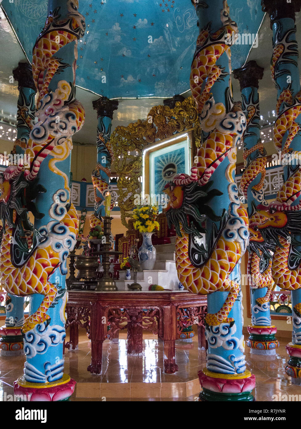 Decorated pillars in Cao Dai Temple in Cai Be symbolise local unique religion indigenous to Vietnam very ornate temple Asia - Stock Image