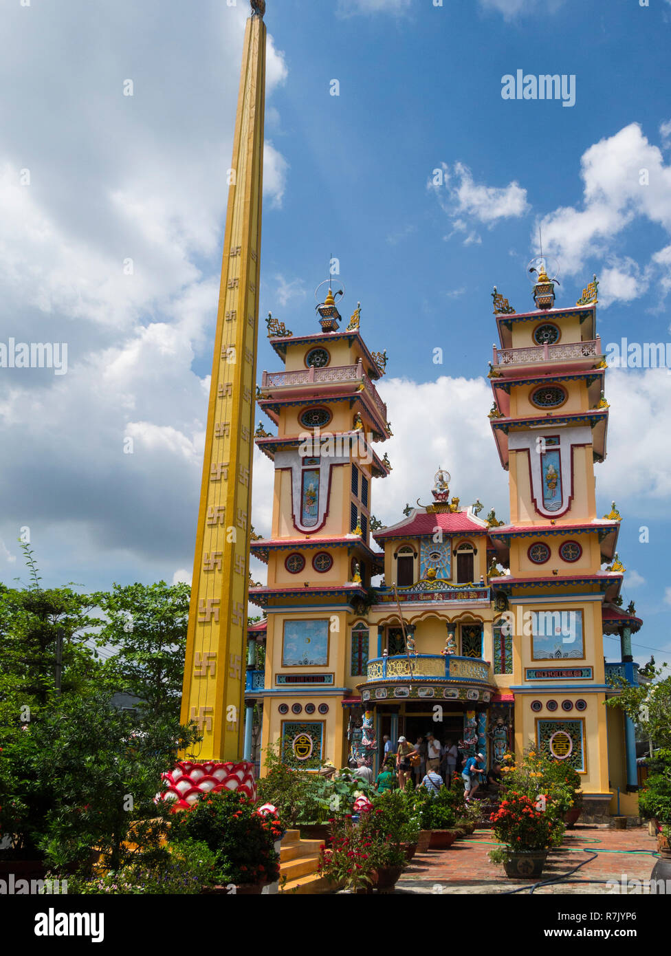 Cao Dai Temple in Cai Be symbolises local unique religion indigenous to Vietnam very ornate temple Vietnam Asia - Stock Image