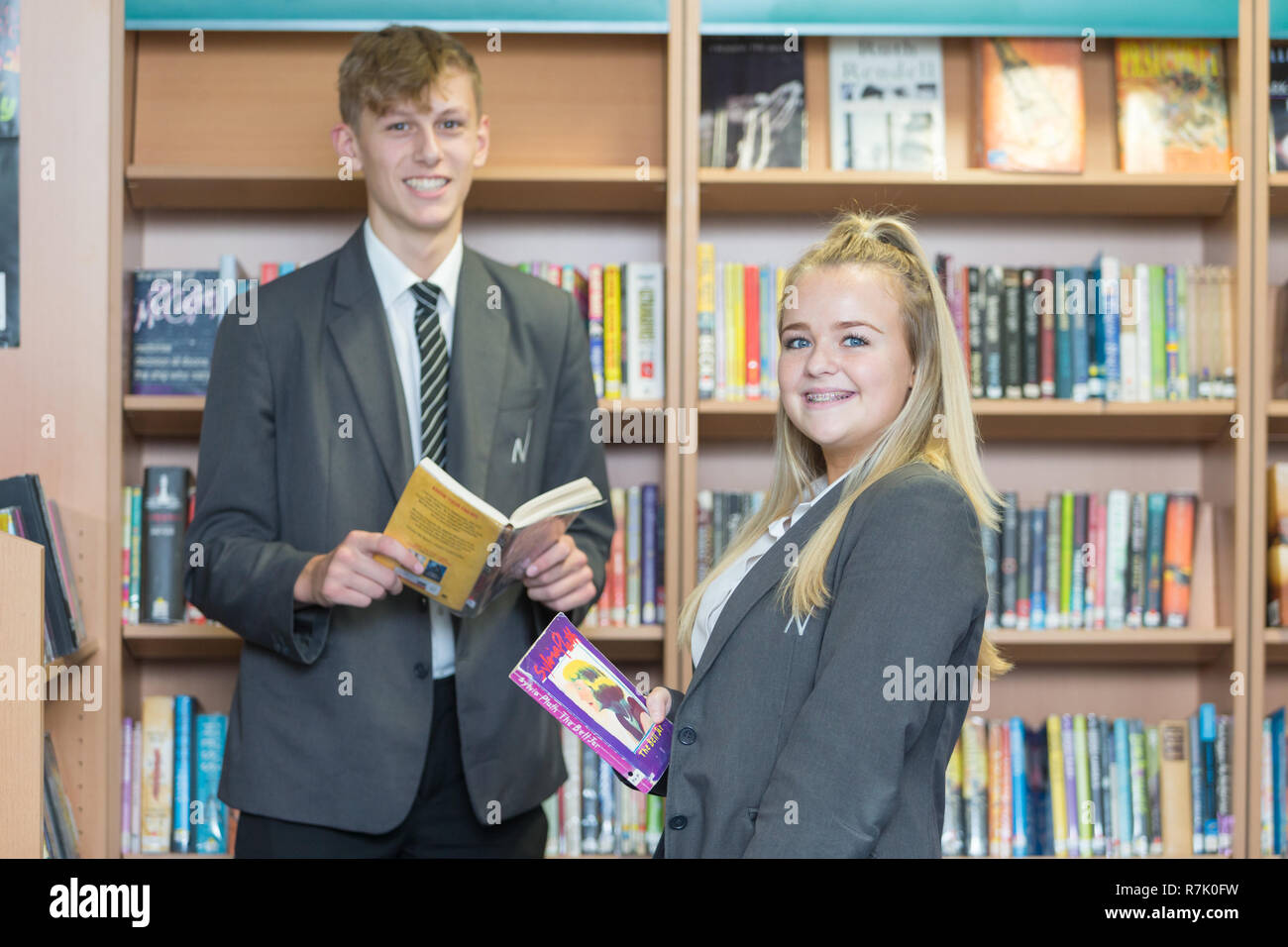 Two teenaged school pupils in a British UK school library - Stock Image