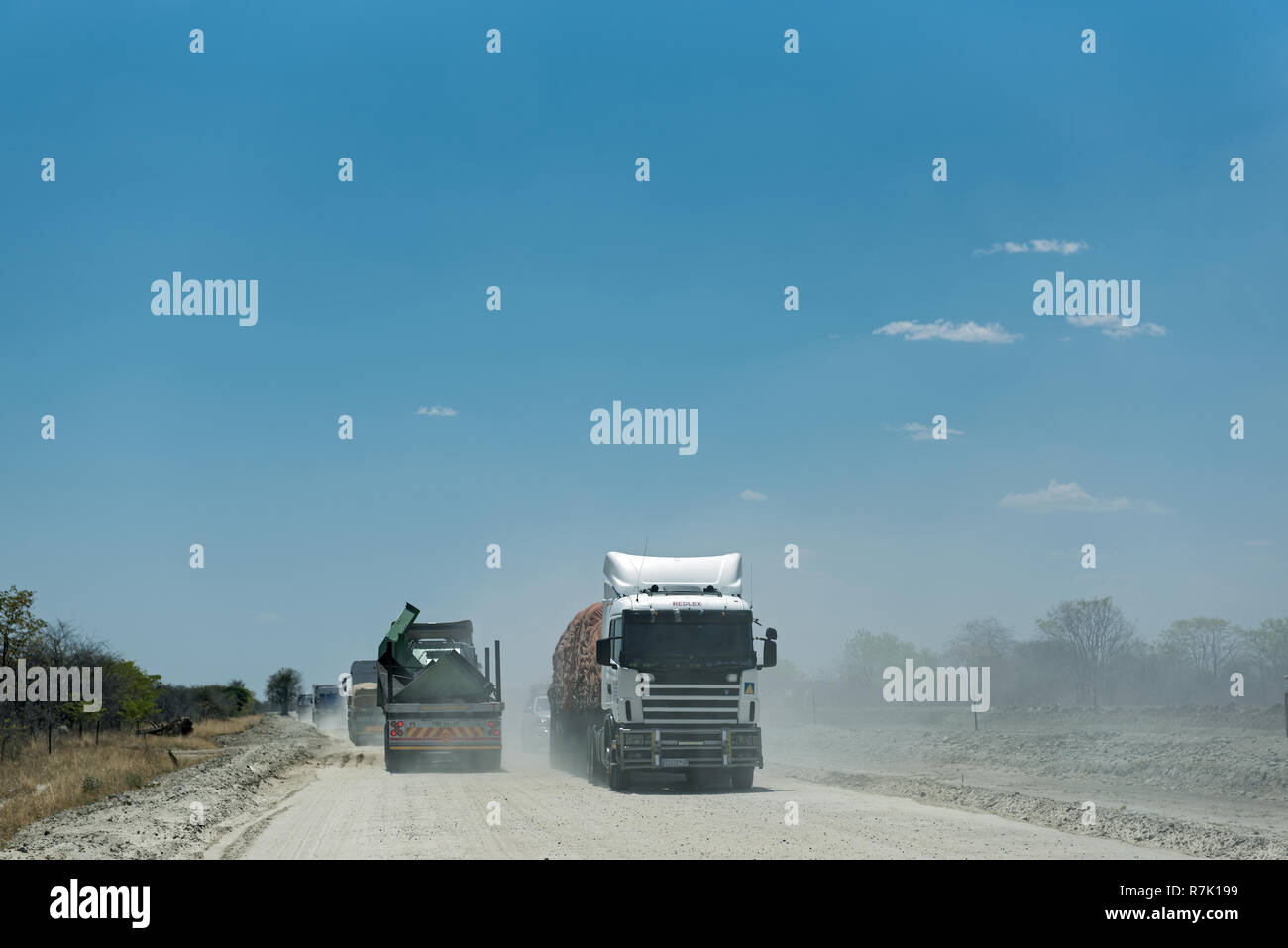 Truck on a dirt gravel road in Botswana - Stock Image