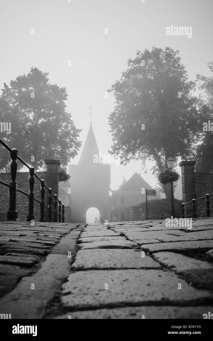 Access through the gate to the fortress town, elburg, gelderland, Netherlands at misty morning - Stock Image