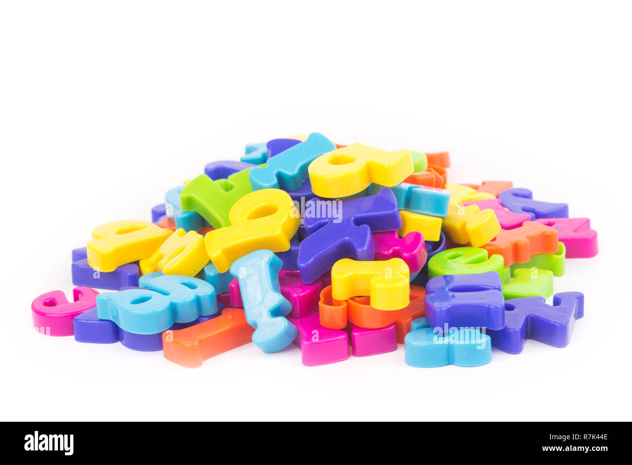 Heap of colourful plastic letters.Concept of education, online and home education. - Stock Image