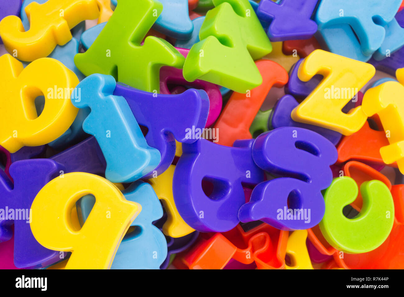 Close up of colourful plastic letters.Concept of education, online and home education. - Stock Image
