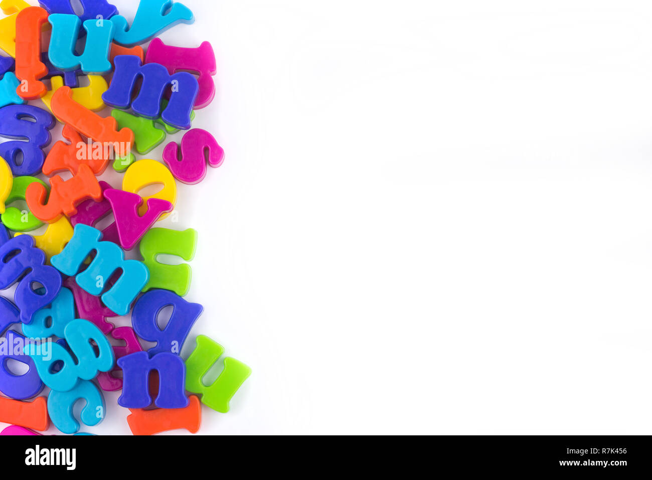 Colourful plastic letters isolated on white.Concept of education, online and home education.Place for a text. - Stock Image
