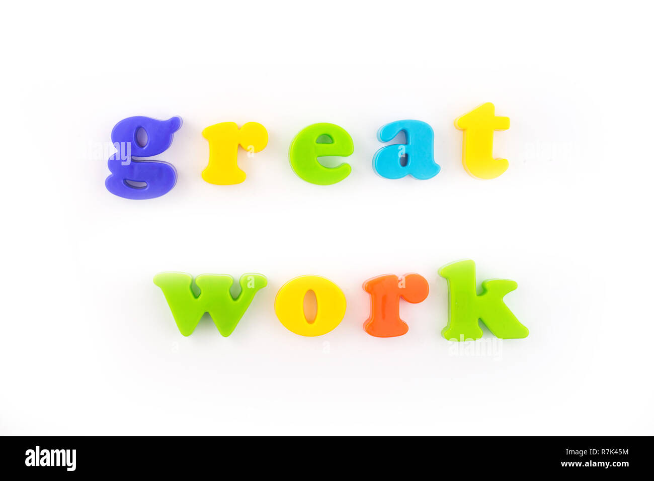 Great work colourful plastic letters isolated on the white .Concept of education, online and home education. - Stock Image