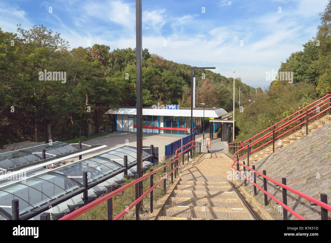 Rhenen, The Netherlands, October 08, 2018: stairs down to Rhenen station with NS group (Nederlandse Spoorwegen) logotype - transoprtation company - Stock Image