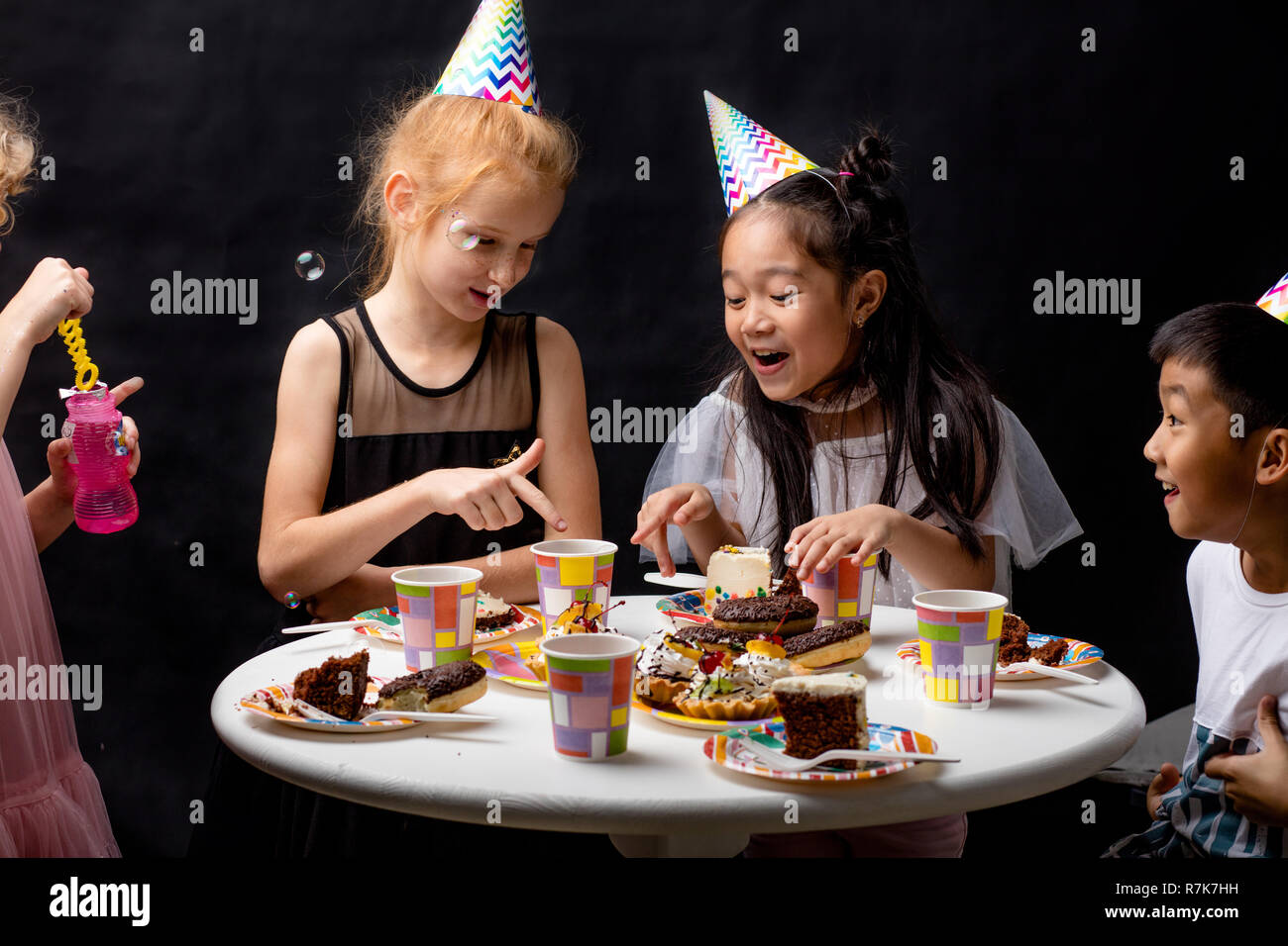 cheerful mixed raec children are rejoicing at bubbles Stock Photo