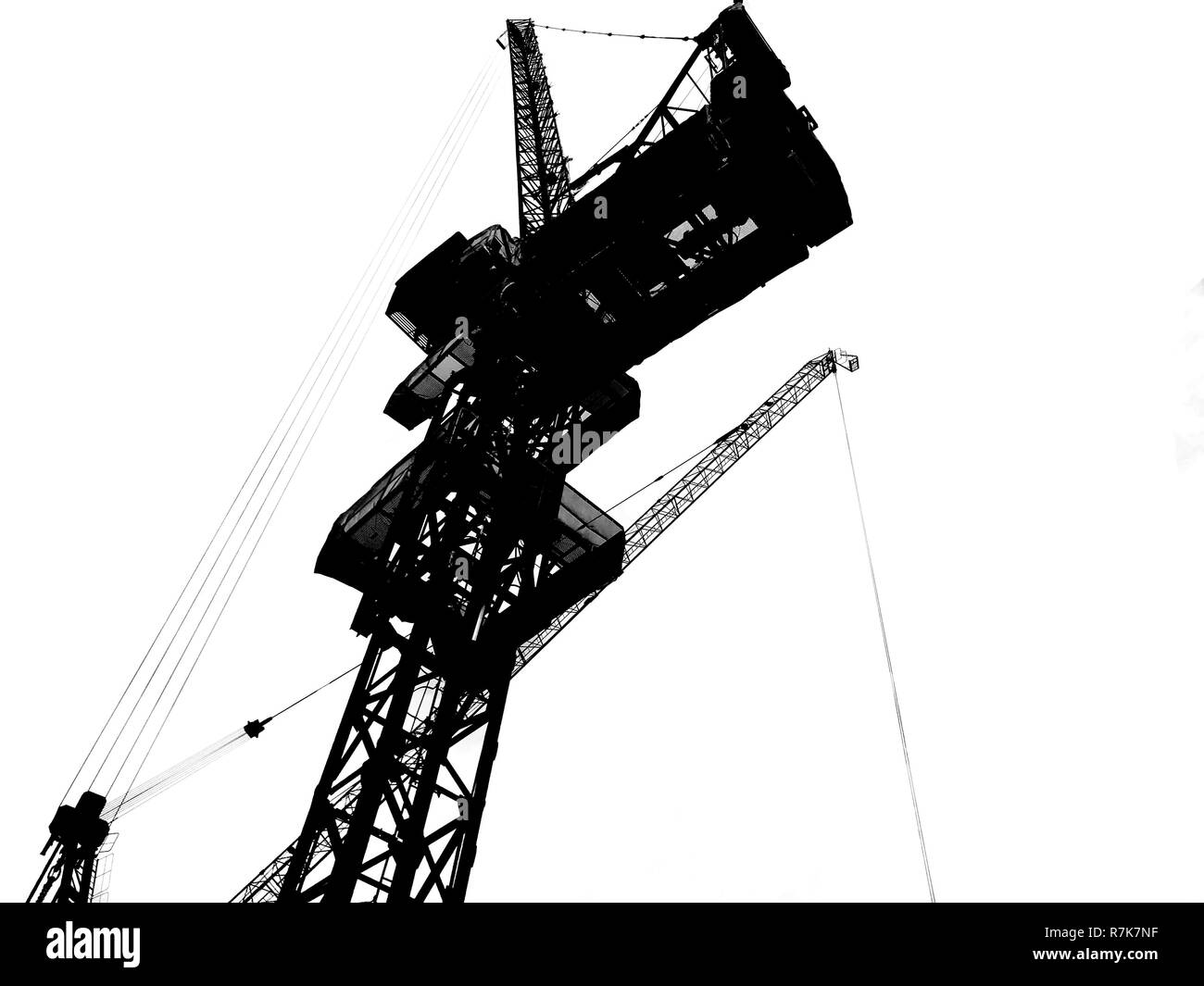 Construction tower crane silhouette isolated on white background. Construction Industry, Transportation Industry, Engineering Tool and Industrial Equi - Stock Image