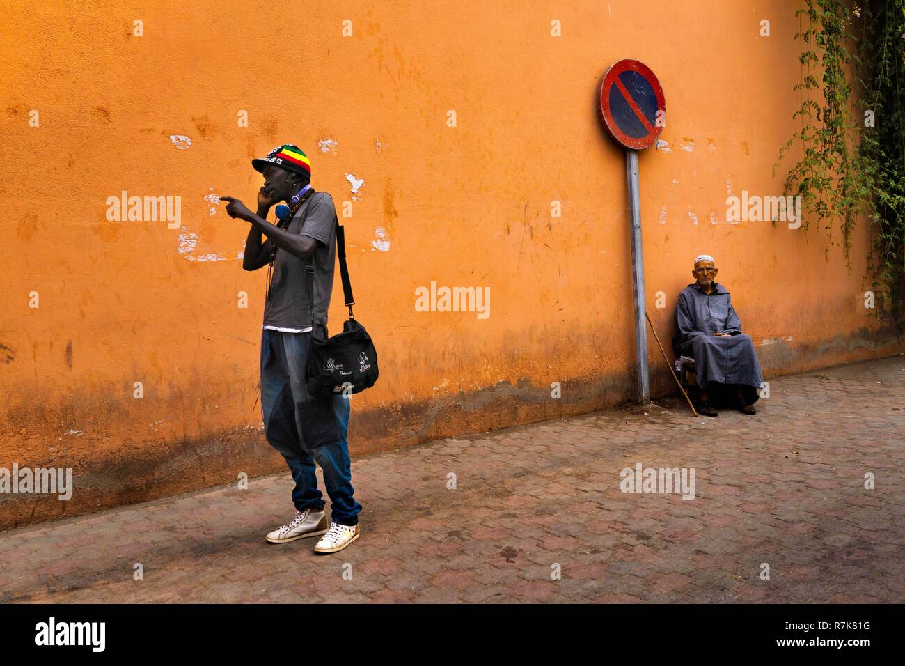 Morocco, Marrakech, a student from sub-Saharan Africa and a Moroccan in gandura - Stock Image
