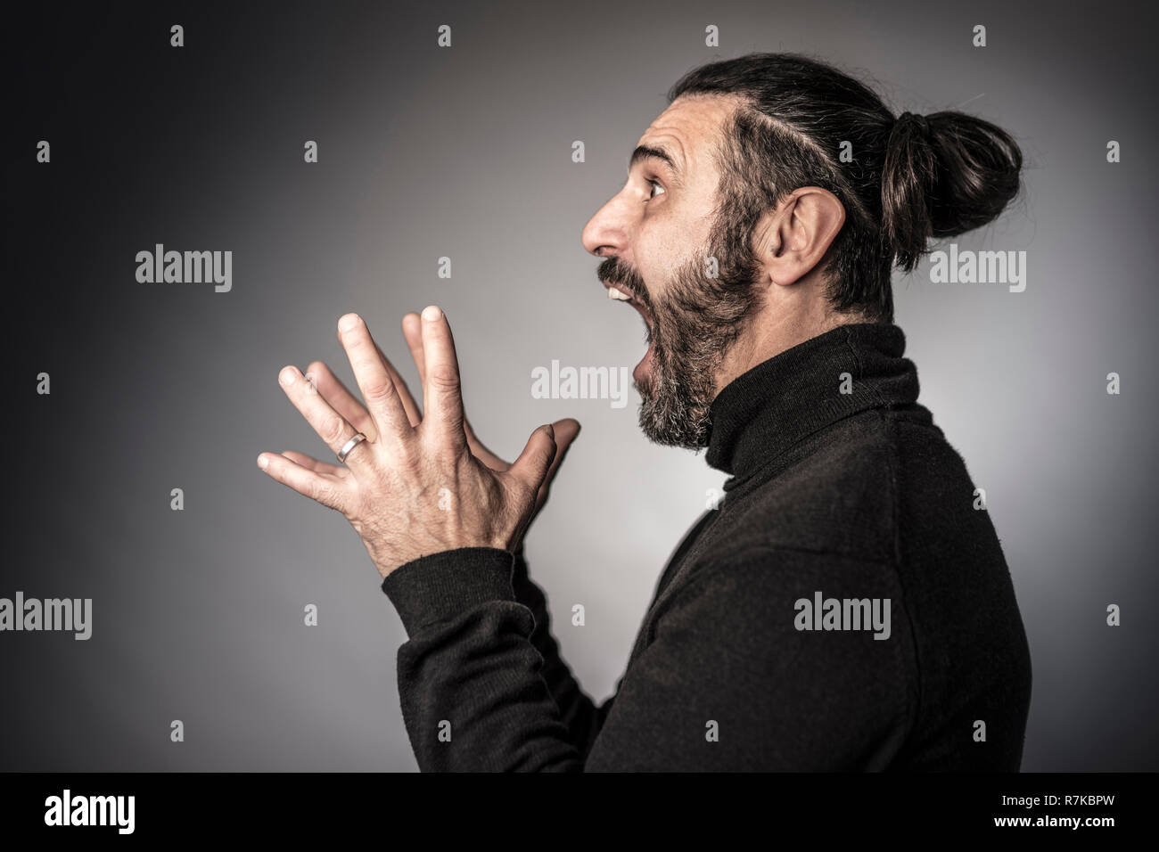 bearded man scary expression studio shot Stock Photo