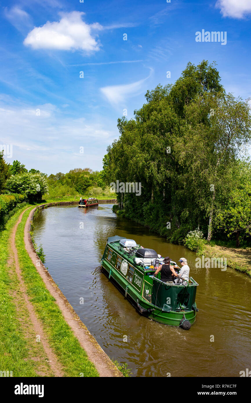 Narrow boats cruising on the Trent and Mersey Canal in Cheshire UK - Stock Image