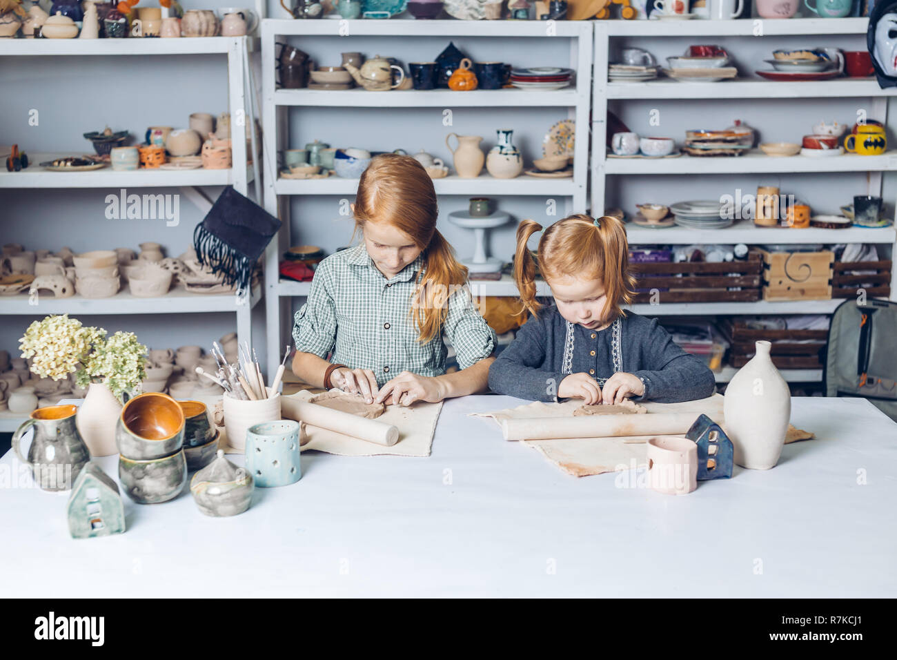 two clever kids modeling in clay Stock Photo