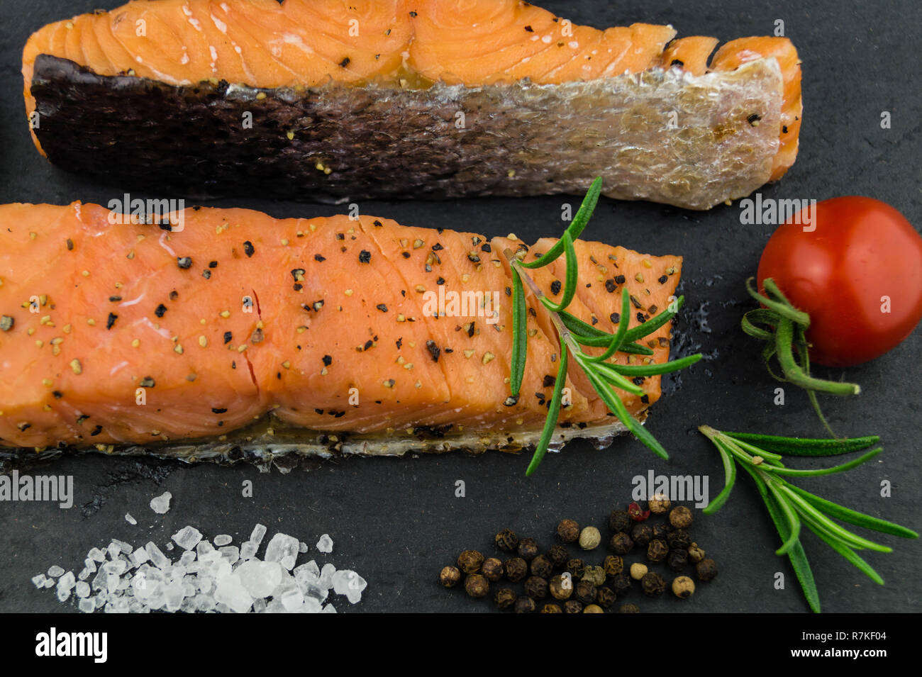 Salted Stripe of Atlantic ocean Salmon peppered and hot smoked - Stock Image