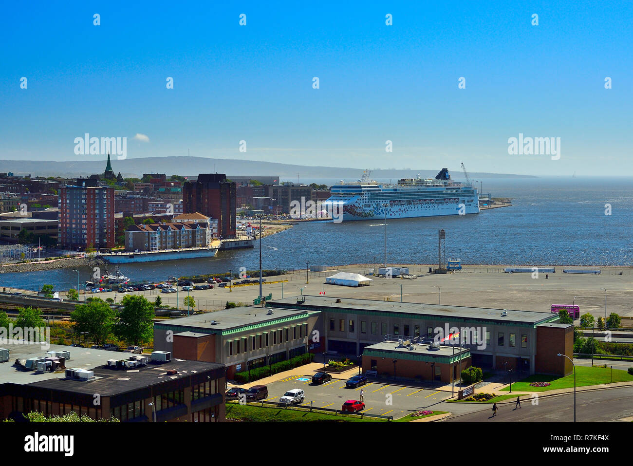 A landscape image of the harbour at Saint John on the Bay of Fundy in New Brunswick showing the waterfront with a passenger ship in port. - Stock Image