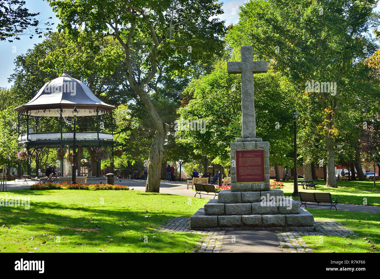 In King Square a stone memorial cross to honor the landing of the first settlers, the loyalist in the city of Saint John New Brunswick Canada. - Stock Image