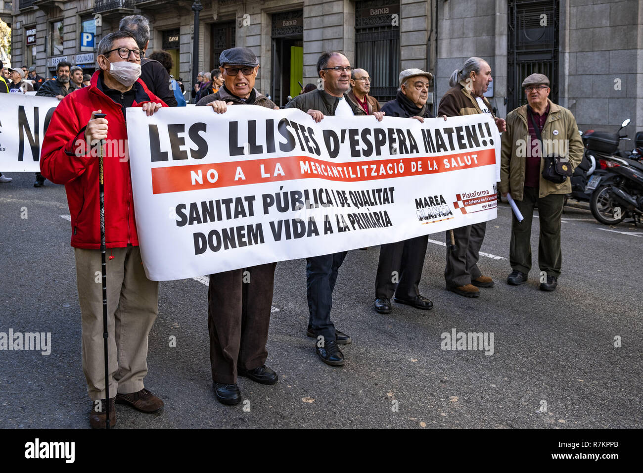 Barcelona, Catalonia, Spain. 10th December, 2018. A group of protesters in a state of retirement are seen holding a banner during the protest.Called by Marea Blanca Catalunya within the state fight against the waiting lists and the commercialization of health, the protesters have toured the center of Barcelona to finish in front of the Generalitat of Catalonia. Credit: Paco Freire/SOPA Images/ZUMA Wire/Alamy Live News - Stock Image