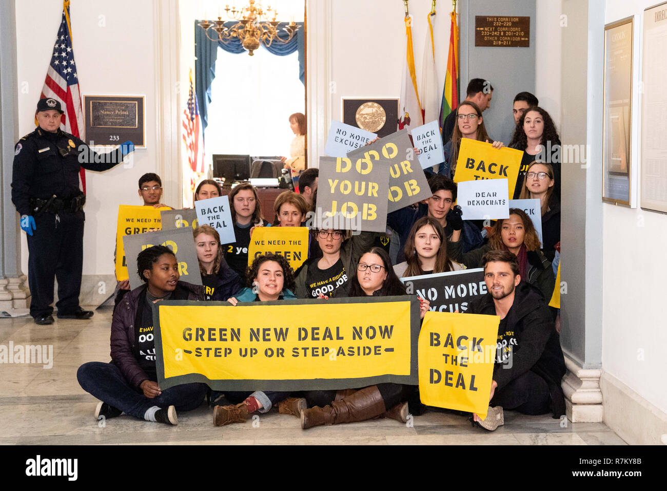 Washington, DC, USA. 10th Dec, 2018. Protesters seen holding placards during the Sunrise Movement protest inside the office of US Representative Nancy Pelosi (D-CA) to advocate that Democrats support the Green New Deal, at the US Capitol in Washington, DC. Credit: Michael Brochstein/SOPA Images/ZUMA Wire/Alamy Live News Stock Photo