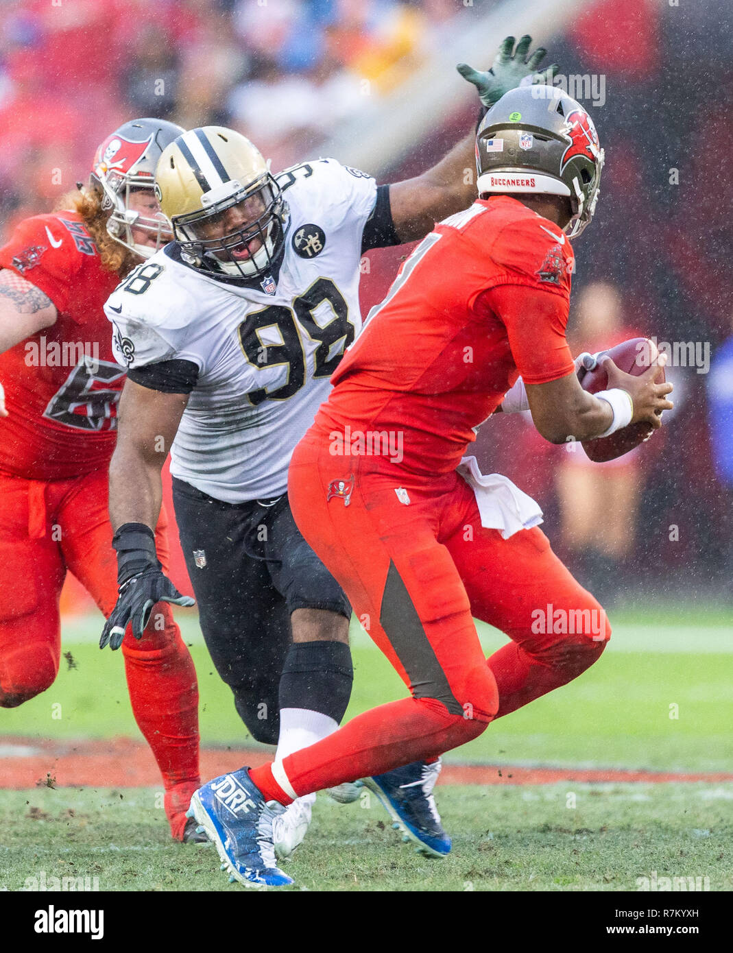 Tampa, Florida, USA. 09th Dec, 2018. New Orleans Saints defensive tackle Sheldon Rankins (98) chases Tampa Bay Buccaneers quarterback Jameis Winston (3) during the game between the New Orleans Saints and the Tampa Bay Buccaneers at Raymond James Stadium in Tampa, Florida. Saints win 28-14. Del Mecum/CSM/Alamy Live News - Stock Image