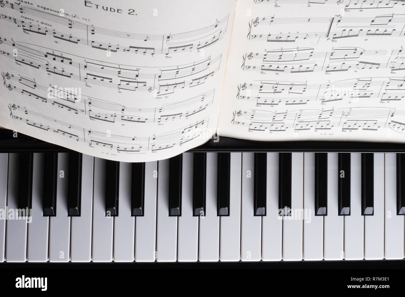 Piano detail with book of music - Stock Image