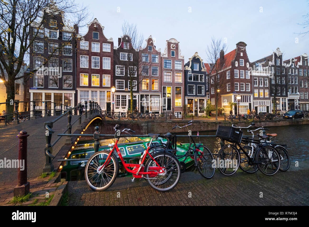 Evening View Of Old Dutch Houses Beside Canal In Amsterdam