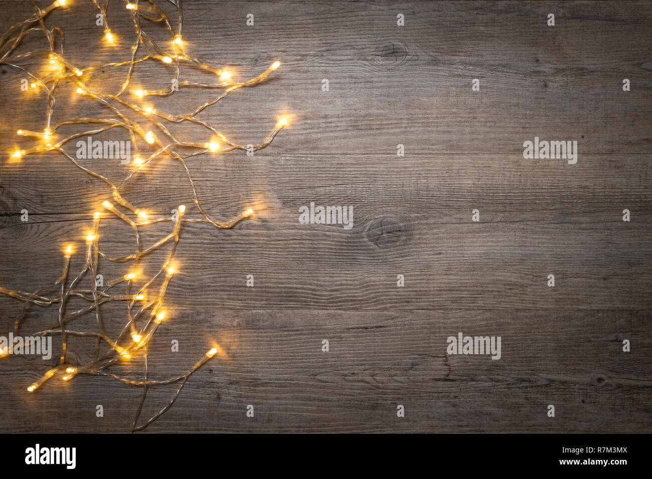 buy popular 8bf40 ef147 flat lay of fairy lights on a wooden board with copy space ...