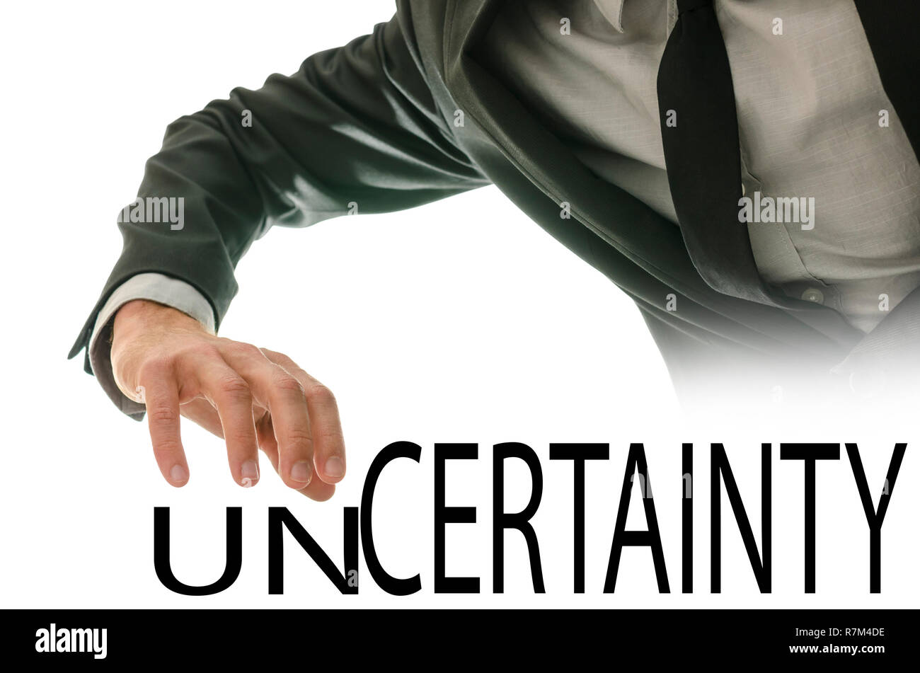 Changing word Unfaithful into Faithful by pushing away letters un. - Stock Image