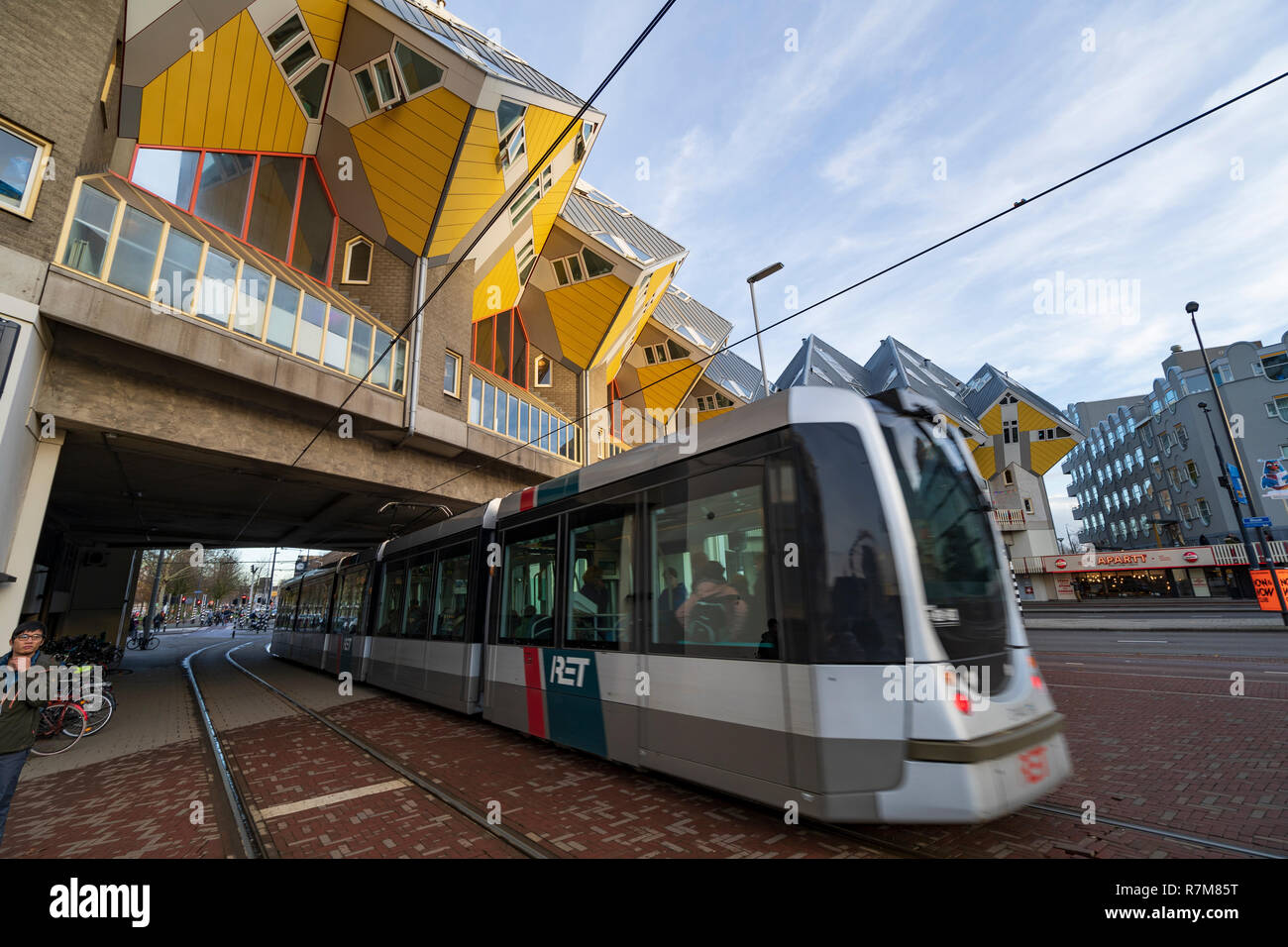 Public tram passes in front of Cube Houses in Rotterdam The Netherlands - Stock Image