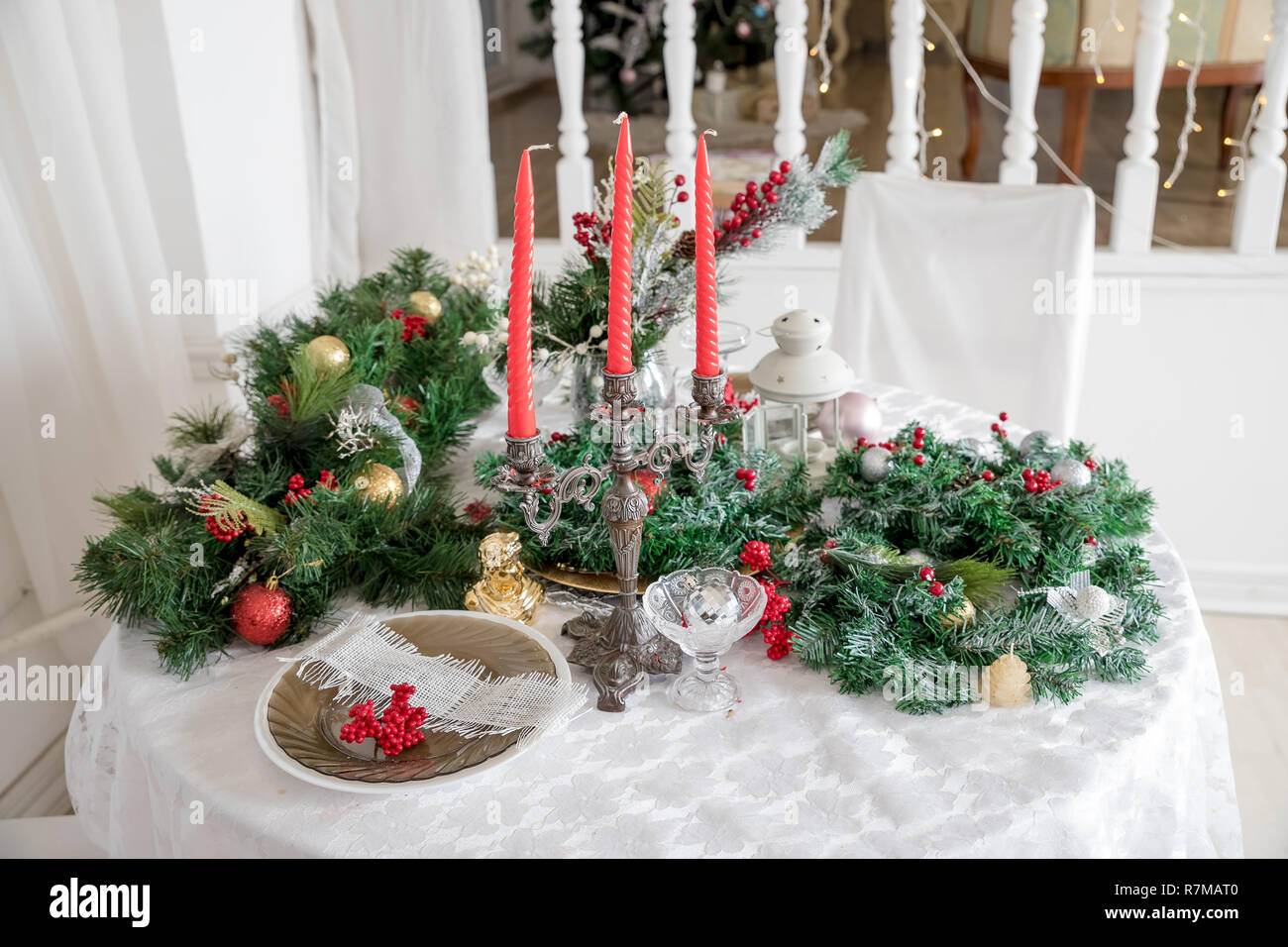 Festive Table Setting Among Winter Decorations And White