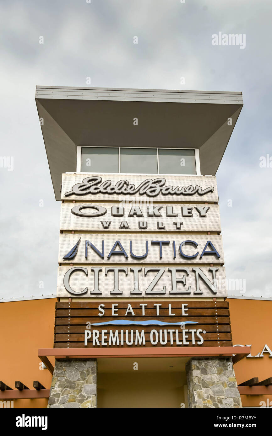 SEATTLE, WA, USA - JUNE 2018: Exterior view of a building at the Premium Outlets shopping mall near Seattle, with signs of designer stores. - Stock Image