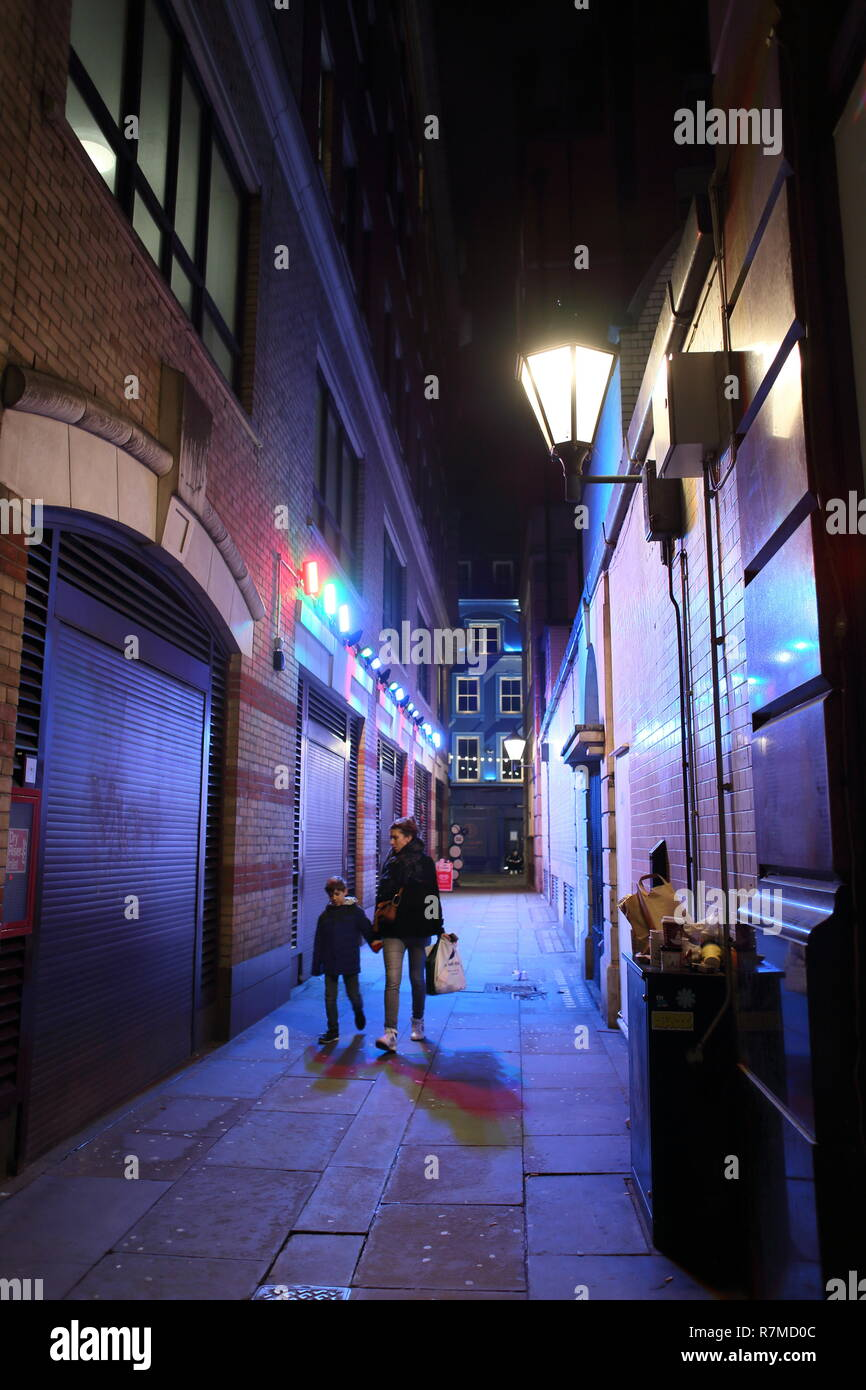 Woman and child walkiing down alleyway in Carnaby Street area, Soho, London, England, UK Stock Photo