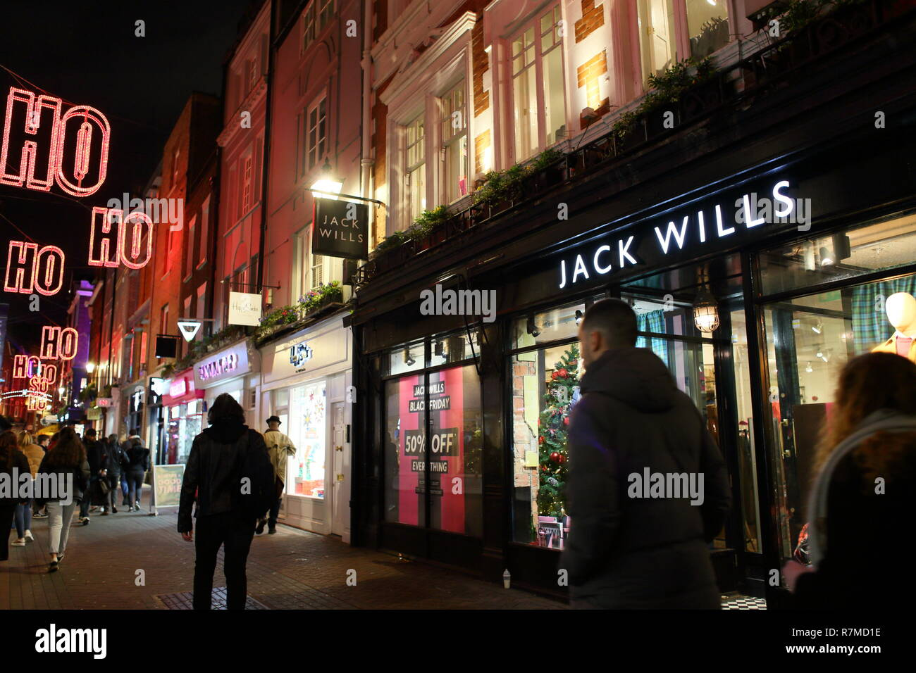 People walking by Jack Wills store in Carnaby Street area, Soho, London, England, UK - Stock Image