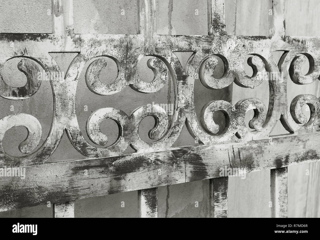 Diminishing perspective of an old wooden decorative fence in monotone - Stock Image