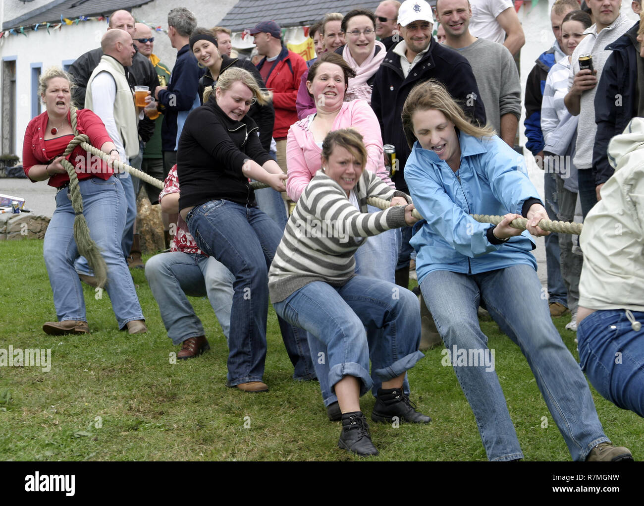 The women take the strain at the tug of war in the small, remote, hamlet of Knoydart and their annual gala day. Knoydart sits on a peninsula in the north west highlands of Scotland and can only be reached by boat or on foot. - Stock Image