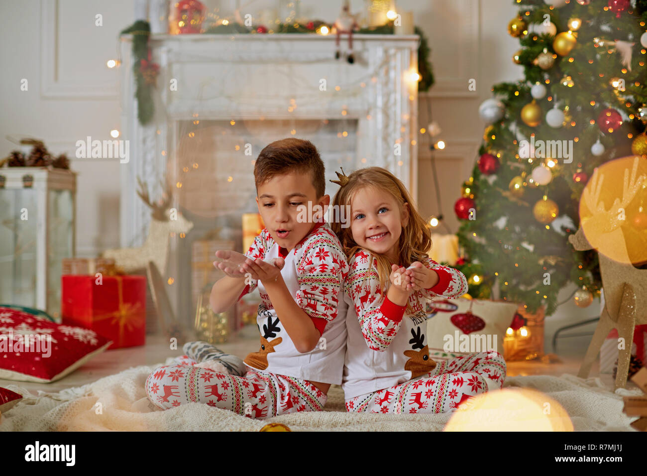 Adorable little girl and boy in Christmas time Stock Photo