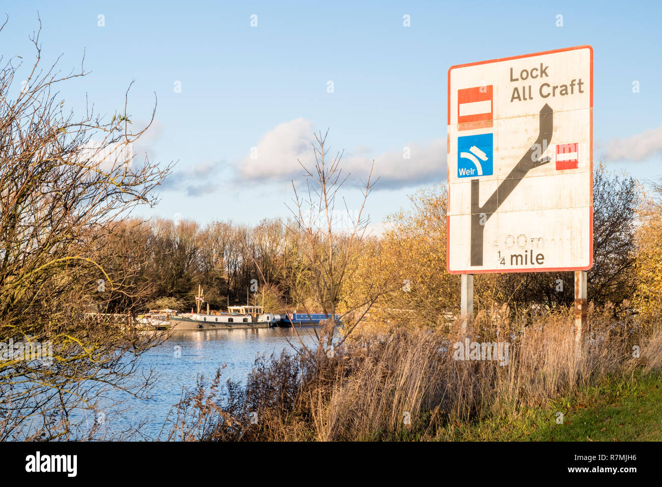 Inland waterway navigation sign showing a lock and weir on the River Trent at Holme Pierpont, Nottinghamshire, England, UK - Stock Image