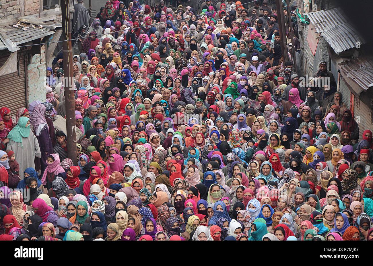Hajin, Kashmir. 10th December, 2018. Women march to attend the funeral of teenage militants in Hajin area of north Kashmir some 35 kilometers from Srinagar the summer capital of Indian controlled Kashmir on December 10, 2018. Fourteen year old was among the three militants killed in 18-hour long gun-battle in Mujigund area on the Srinagar outskirts on December 09, 2018. Credit: Faisal Khan/Pacific Press/Alamy Live News Stock Photo