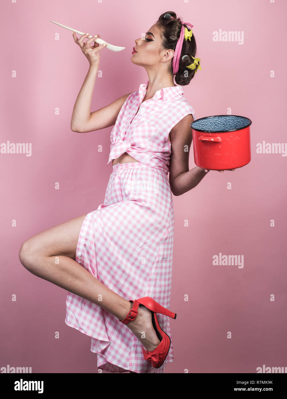 e71a58fd9bcd ... hair. pin up woman with trendy makeup. perfect housewife. retro woman  cooking in kitchen. pretty girl in vintage style. Enjoying healthy lifestyle