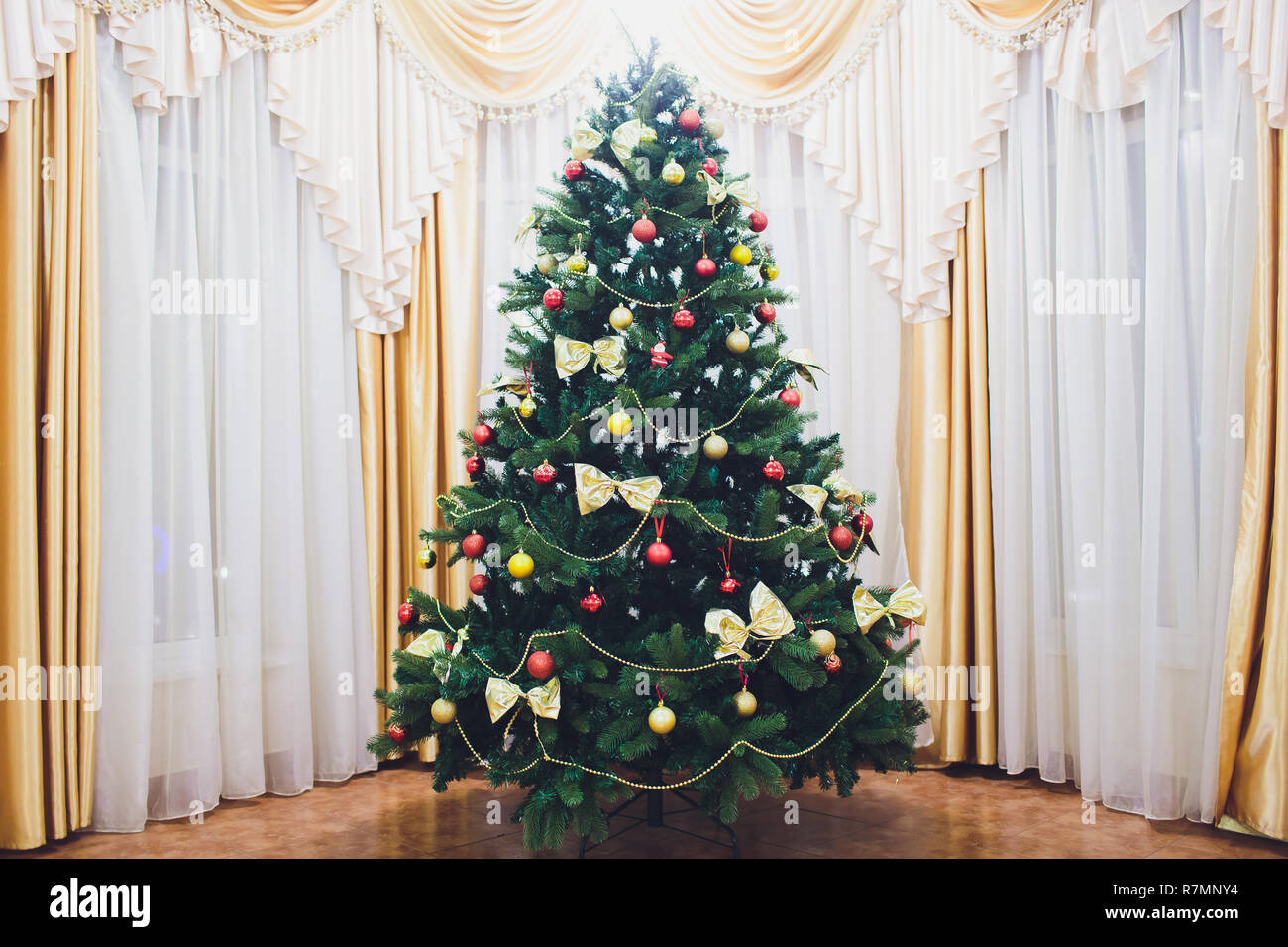 Decorated Christmas room with beautiful fir tree. - Stock Image
