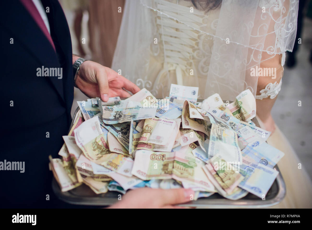 Russian money on the blue plastic tray. - Stock Image