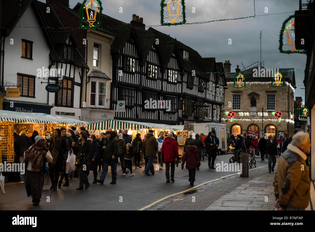 Victorian Christmas Market and lights in historic Union Street at night, Stratford upon Avon, England Stock Photo