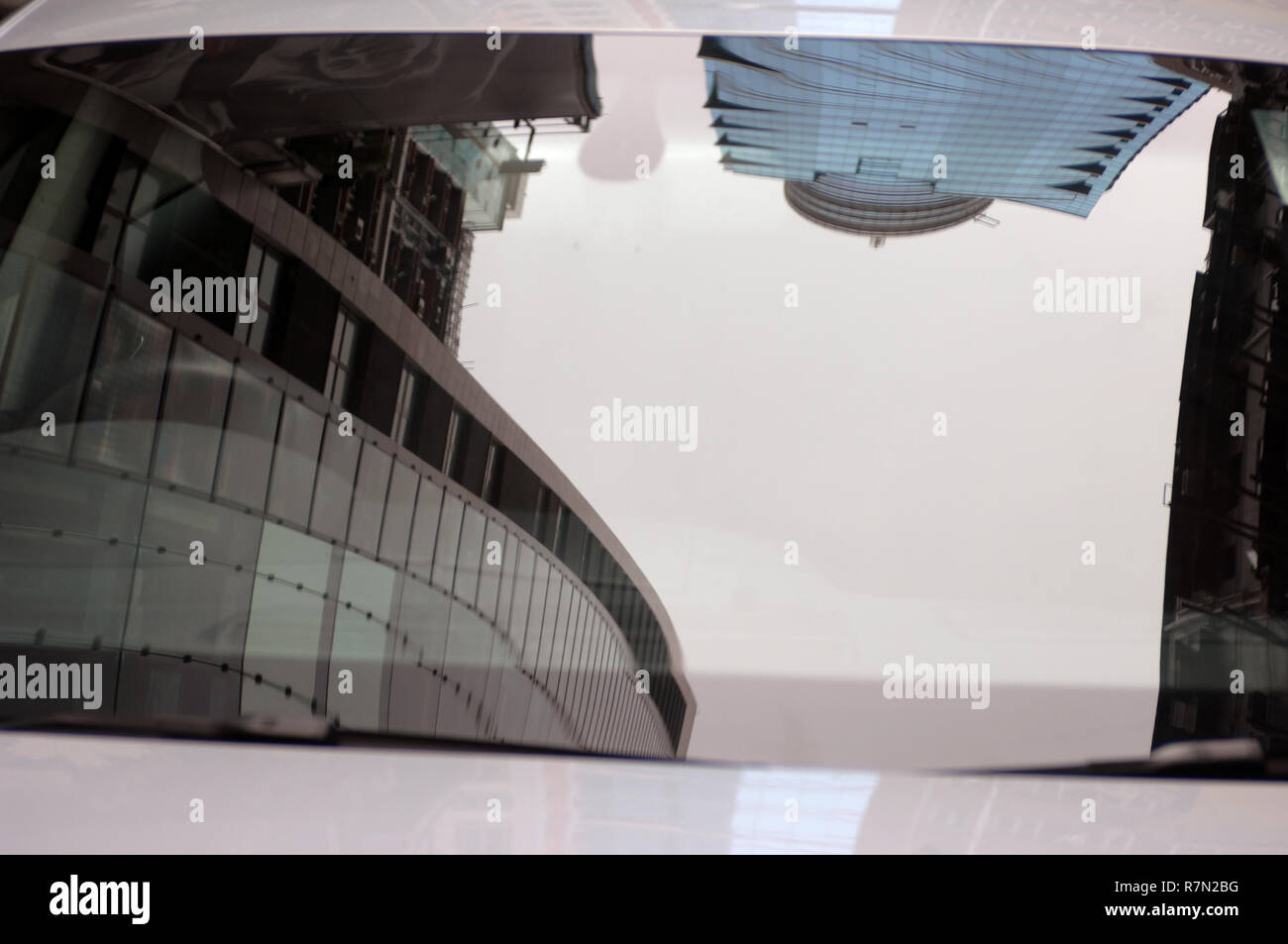 Reflection of high rise office buildings in a car windscreen, Hong Kong, China. Stock Photo