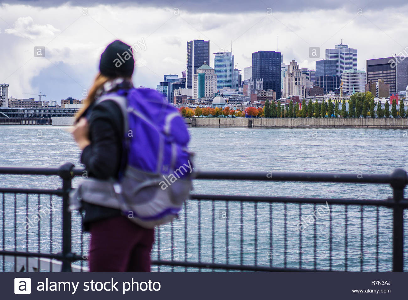 Solo woman traveller exploring with city skyline, Montreal, Quebec, Canada - Stock Image