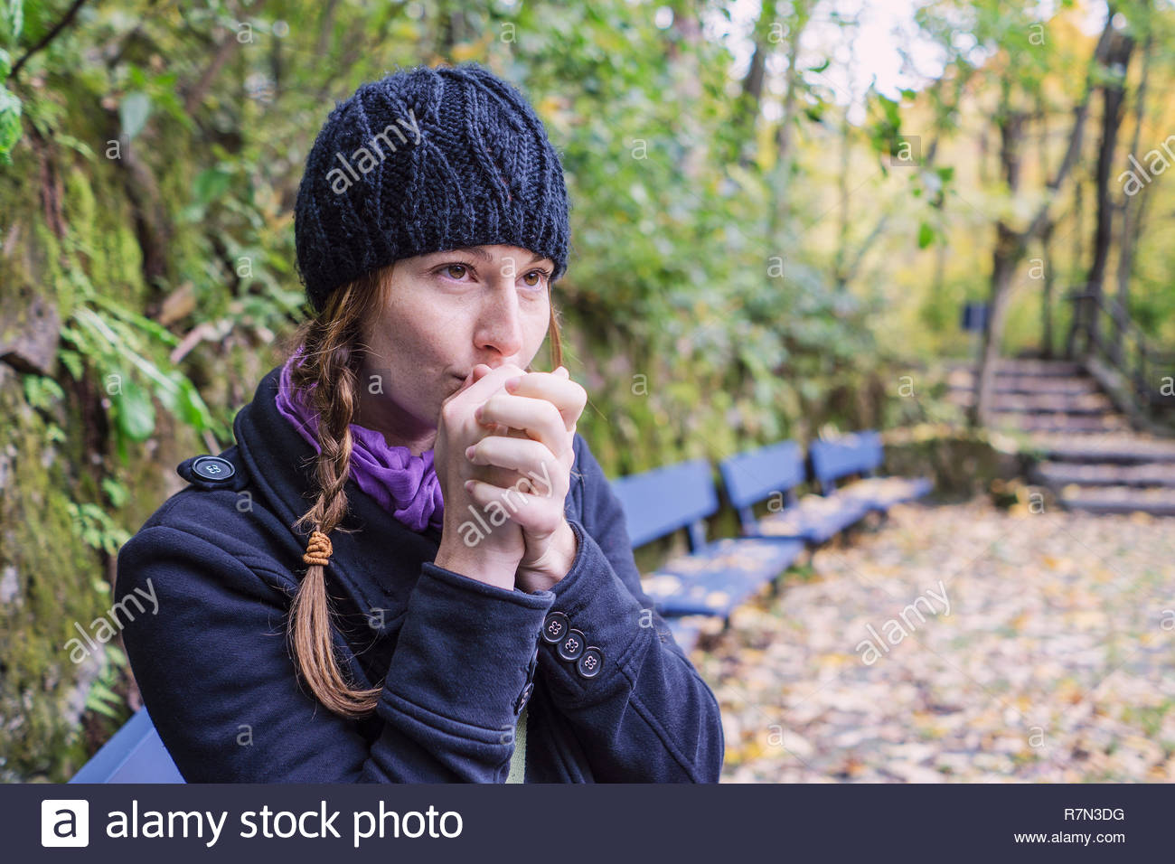 Solo woman traveller exploring park during autumn, Montreal, Quebec, Canada - Stock Image