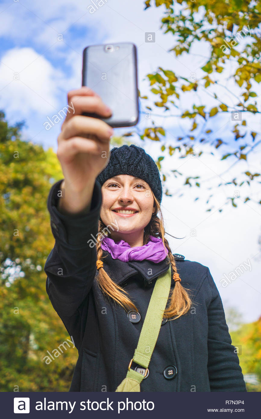 Solo woman traveller using smartphone to take pictures , Montreal, Quebec, Canada - Stock Image