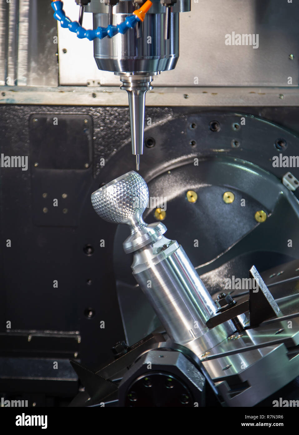 Machining steel cup on industrial milling machine - Stock Image