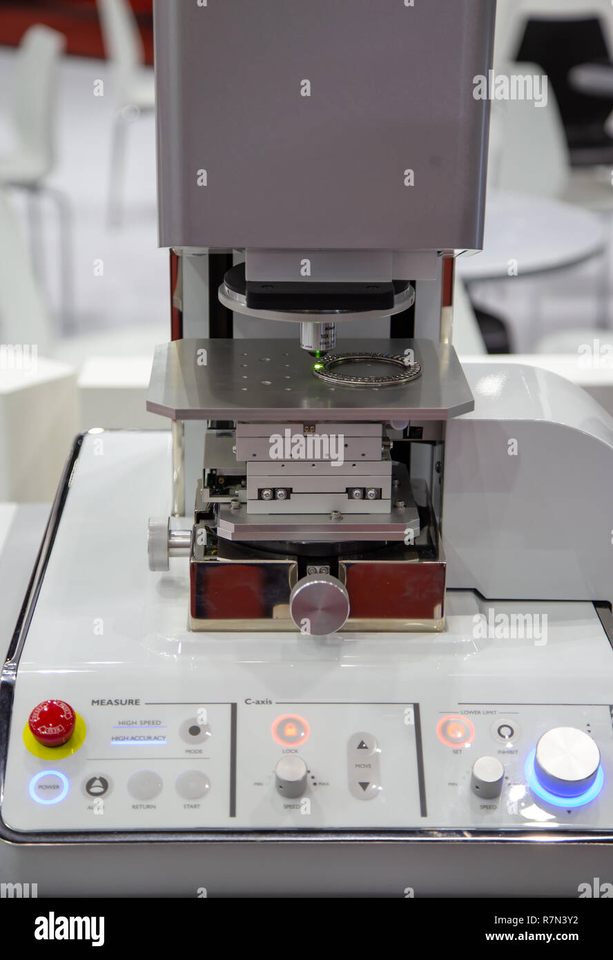 Surface roughness evaluation of workpiece by microscope - Stock Image