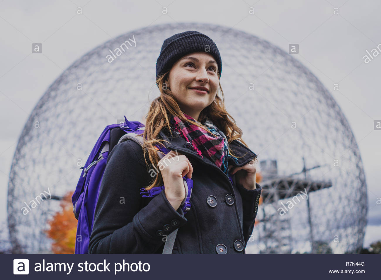 Solo woman traveller exploring landmark during autumn, Montreal, Quebec, Canada - Stock Image