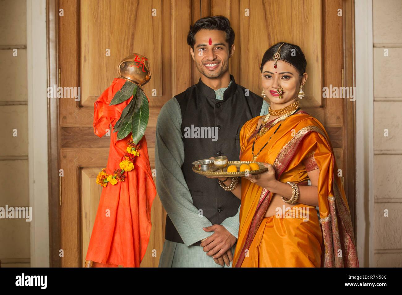 Happy Maharashtrian Couple In Traditional Dress Celebrating Gudi Padwa Festival Holding A Pooja Plate And Posing Stock Photo Alamy
