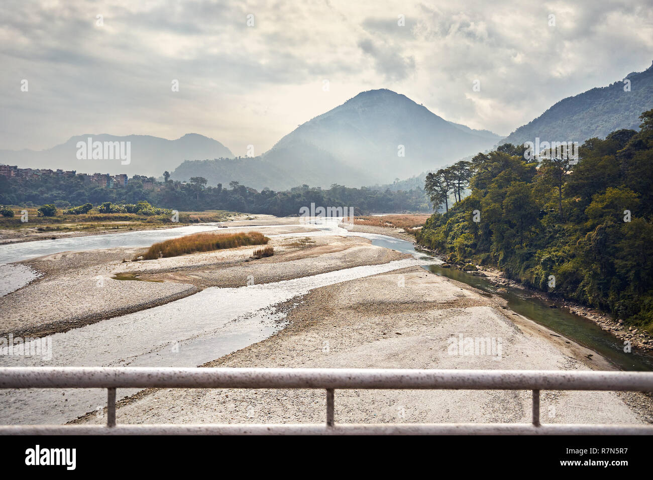 Foggy Mountains and river at Himalayas near Pokhara in Nepal - Stock Image